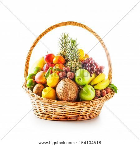Basket of fresh fruits. Healthy eating and dieting concept. Winter assortment. Single object on white background clipping path included