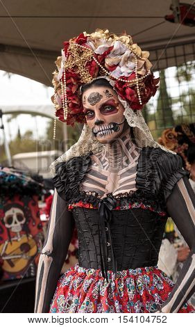 Los Angeles, CA, USA - October 29, 2016: Skeleton woman performer at Dia de los Muertos, Day of the dead, in Los Angeles at the Hollywood Forever Cemetery grounds. Editorial use only.