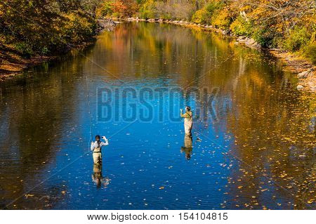 Livingston Manor NY USA - October 15 2016. Fly fishing lesson on Willowemoc Creek- October 15 2016. Fly fishing lesson on Willowemoc Creek