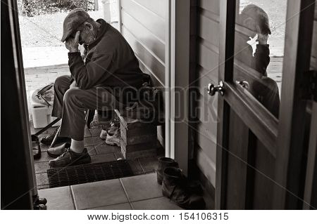 Elderly man feels unwell and sick in his home.(BW)