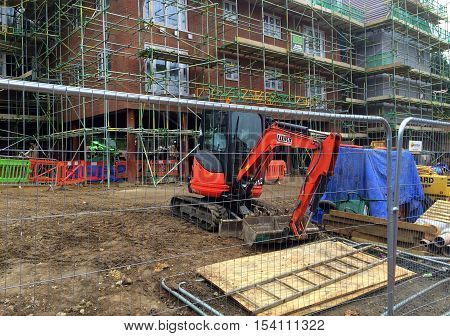 Bracknell,England - October 30, 2016: An apartment block surrounded by scaffolding and construction equipment on a building site in Bracknell, England. The industry is expected to grow over 2% in 2017