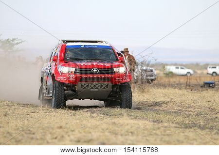 Speeding Red And Black Toyota Hilux Twin Cab Rally Car Front View