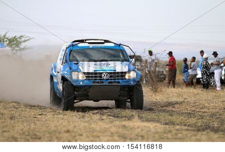 Speeding Blue And White Vw Amarok Twin Cab Rally Car Front View