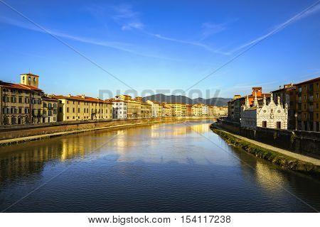 Pisa Arno river sunset from Solferino bridge. Lungarno view and Santa Maria della Spina small gothic church. Tuscany Italy Europe