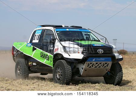Close-up View Of Speeding Green And White Toyota Hilux Twin Cab Rally Car