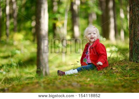 Adorable Girl Hiking In The Forest On Autumn Day