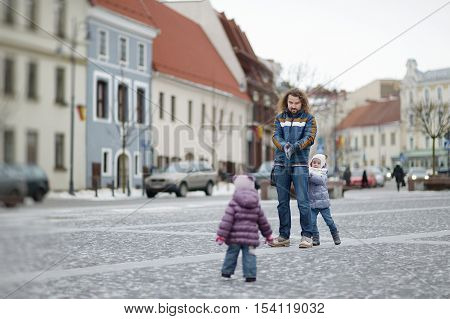 Young Father And His Girls On Winter Day