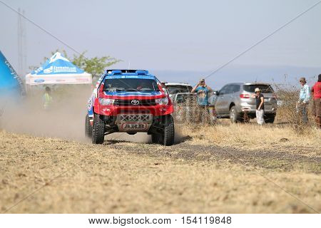 Speeding Red And Blue Toyota Hilux Twin Cab Rally Car Front View