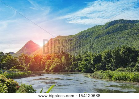 motain bluesky and river at kanchanaburi in thailand and flare