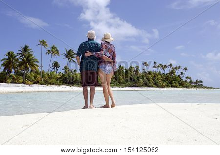 Young Couple Hugs On Deserted Tropical Island