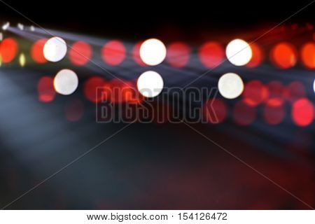 Stage lights on concert. Lighting equipment with multi-colored beams. abstract background.
