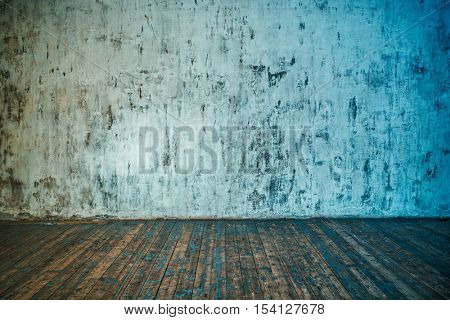 Stone wall and wooden floor background. Blue and red color tinting.