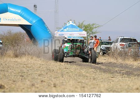 Speeding Green Zarco Magnum Rally Car At Start Of Race