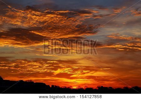 Red, Cloudy Sky At Sunset