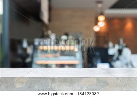 Empty concrete table top with blurred coffee shop stock photo