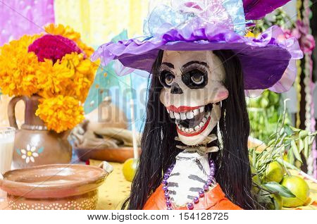 XALAPA, VERACRUZ, MEXICO- OCTOBER 28, 2016: Traditional catrina. Part of a mexican day of the dead offering altar in Xalapa, Veracruz, Mexico