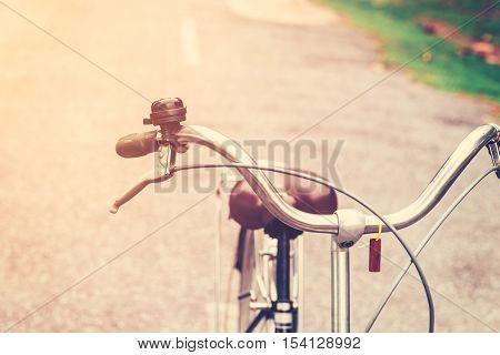 Handlebar Vintage Bicycle On Street Road With Vintage Toned