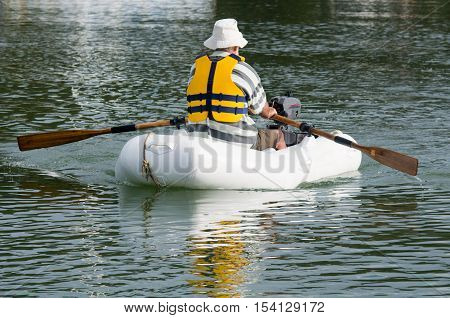 Man Rows Dinghy Boat