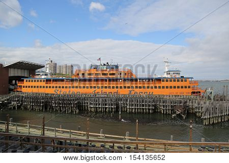 NEW YORK - OCTOBER 25, 2016: Staten Island Ferry docked at St. George Ferry Terminal on Staten Island. Every day, over 65,000 people ride the Staten Island Ferry