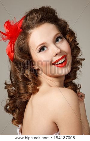 Pin-up girl close-up portrait.Professional make-uphair and style.