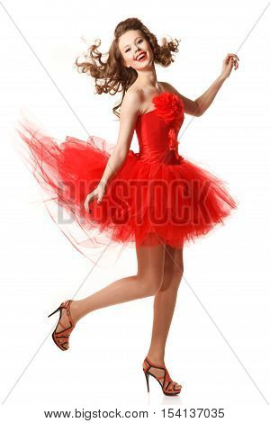 Pin up girl in red dress is jumping. Professional make-up hair and style