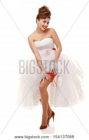 Pin-up bride standing.Professional make-up hair and style