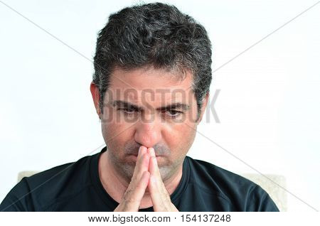 Mature Man Thinking With Hands On His Mouth