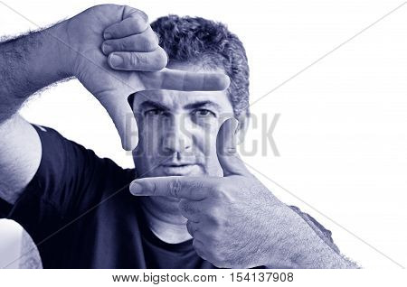 Serious Mature Man Creating Frame With Fingers
