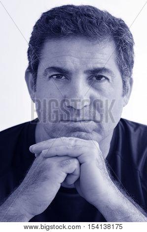Mature Man Looks At The Camera