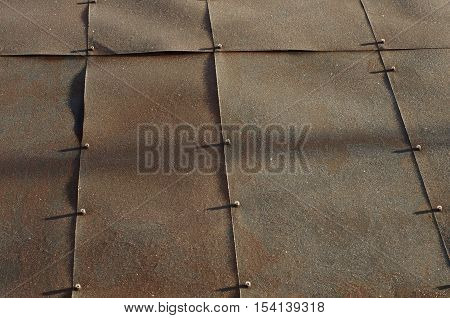 Not painted rusty metal sheet covered with hoarfrost