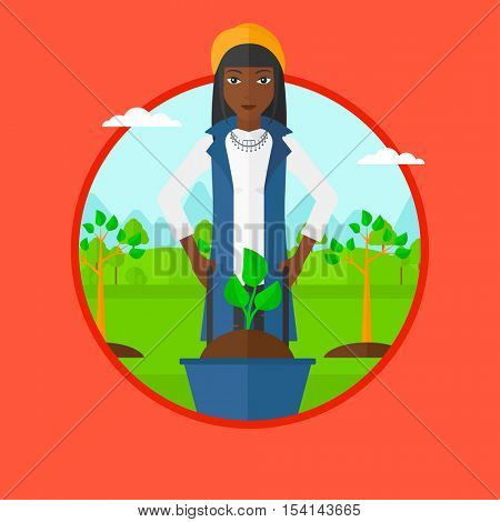 An african woman pushing wheelbarrow with plant and dirt in park. Gardener with wheelbarrow on a background of newly planted trees. Vector flat design illustration in the circle isolated on background