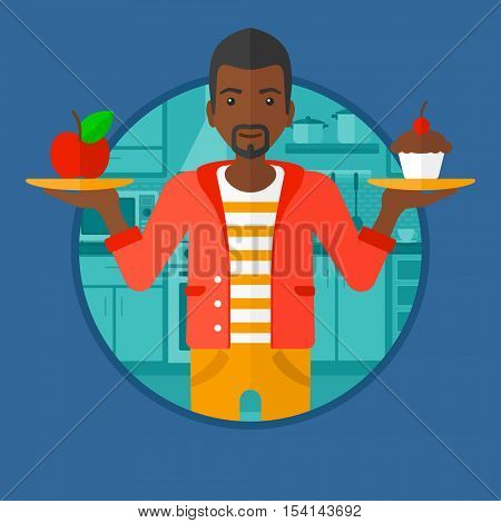 An african-american man standing with apple and cupcake in hands in the kitchen. Man choosing between apple and cupcake. Vector flat design illustration in the circle isolated on background.