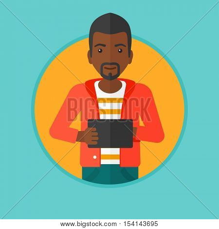 An african-american young man holding a tablet computer. Student working on tablet computer. Smiling man with digital tablet. Vector flat design illustration in the circle isolated on background.