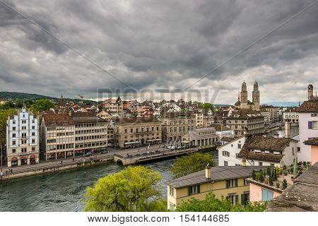 Zurich Switzerland - May 24 2016: Architecture of Zurich. Aerial view of Zurich old town and River Limmat from Lindenhof hill in Zurich on a cloudy day Switzerland.