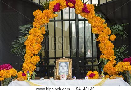 XALAPA, VERACRUZ, MEXICO- OCTOBER 28, 2016: Part of a mexican day of the dead offering altar decorated with flowers