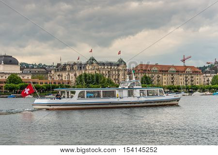 Zurich Switzerland - May 24 2016: Excursion ship Bachtel on a round trip on Lake Zurich in cloudy weather Zurich Switzerland Europe. Lake Zurich is a lake in Switzerland extending southeast of the city of Zurich Switzerland.