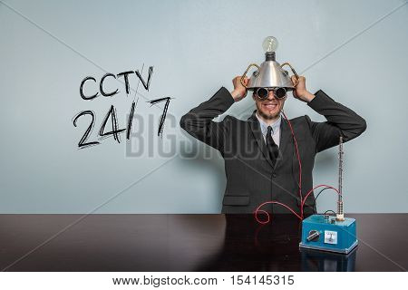 Cctv 247 text with vintage businessman and machine at office