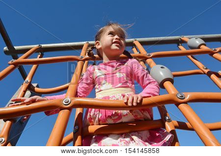 Little Girl Play In Playground