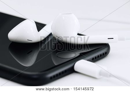 Bangkok Thailand - October 28 2016: Close-up earpods on iPhone 7 matte black new iPhone 7 available with new earpods lightning cable