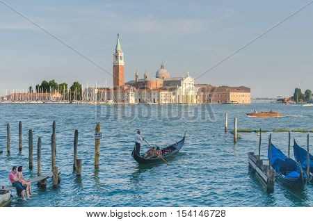 VENICE ITALY - JUN 11 2014: Venice a city in northeastern italy. It is famous for the beauty of its settings archtecture and artwork. A part of Venice is resignated as a World Heritage site.