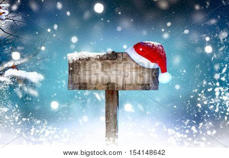 Christmas Holiday Wooden signboard. Evening Landscape With Christmas Wooden Greeting Signboard.