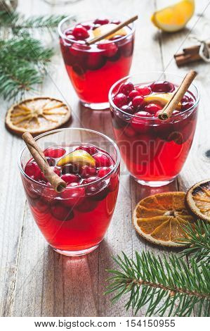 Mulled wine with cranberries, orange wedge and spices in cups. Christmas or New Year drink. Festive still life
