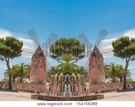 Photomontage two old historic windmill at a country estate in Mallorca (Spain)