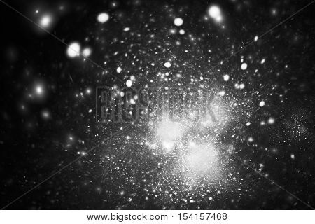 Supernova explosion. Abstract monochrome sparks on black background. Fantasy black and white fractal texture for posters postcards or t-shirts.