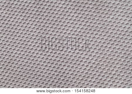 Gray background from soft fleecy fabric closeup. Texture of textile macro.
