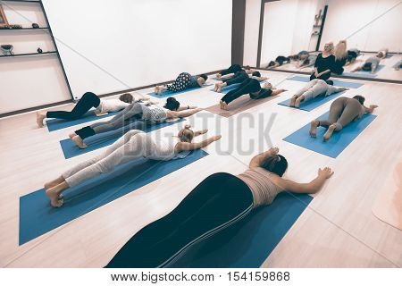 Girls Practicing Yoga, Chaturanga Dandasana, Four Limbed Staff Pose..