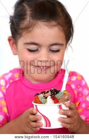 Little Girl Eats Ice Cream