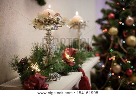 Winter Candle Holders With Candles At The Christmas Tree Background