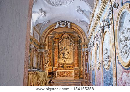 MONREALE ITALY - OCTOBER 10 2016: The stone Chapel in Monreale Cathedral with amazing sculptures relief stone mosaic on the altar and fretwork on ceiling on October 10 in Monreale.