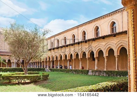 MONREALE ITALY - OCTOBER 10 2016: The Monreale Cloister is famous for the old garden decorated with unique columns of covered gallery on October 10 in Monreale.